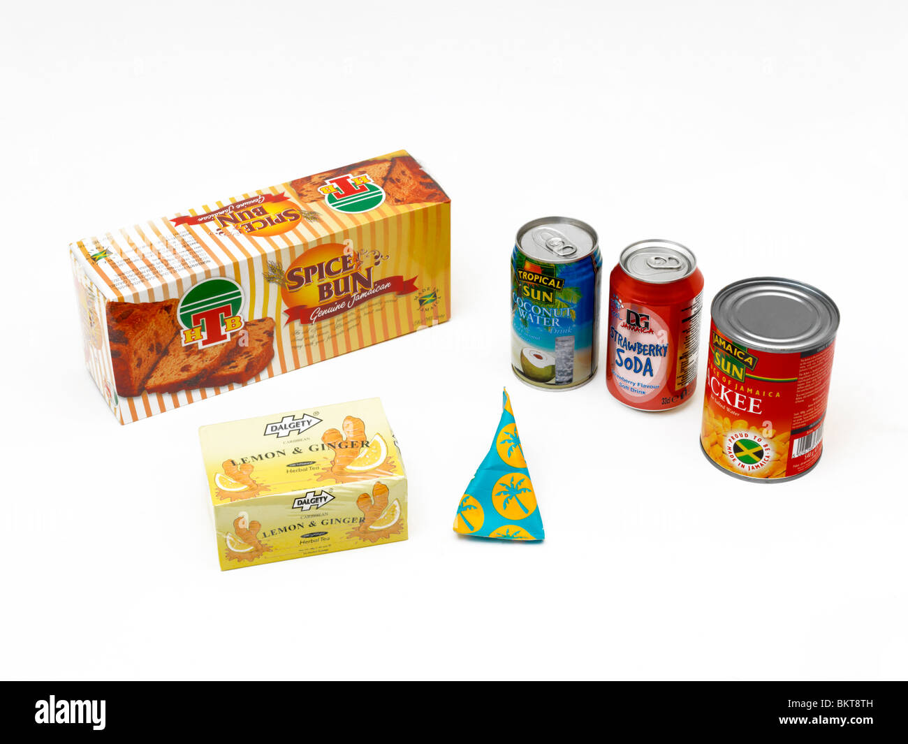 Selection Of Packets Of Caribbean Food In Shapes Of Prisms, Triangular, Cylindrical And Cuboid Stock Photo