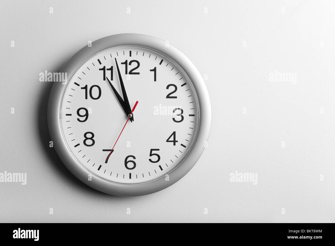 Clock on the wall - Stock Image