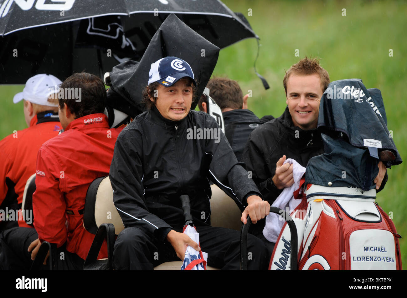 The french golfer Michael Lorenzo-Vera grimaces in the welsh rain during a buggy ride back from the practice range - Stock Image