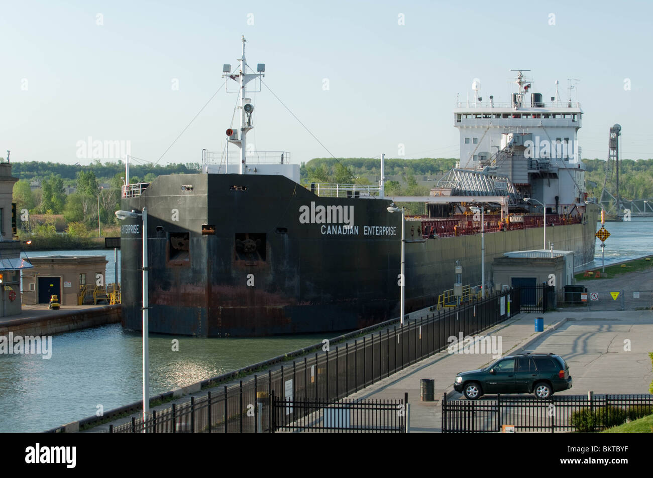 Self unloading bulk commodities carrier 'Canadian Enterprise' negotiates a tight fit into Lock 3 of the - Stock Image