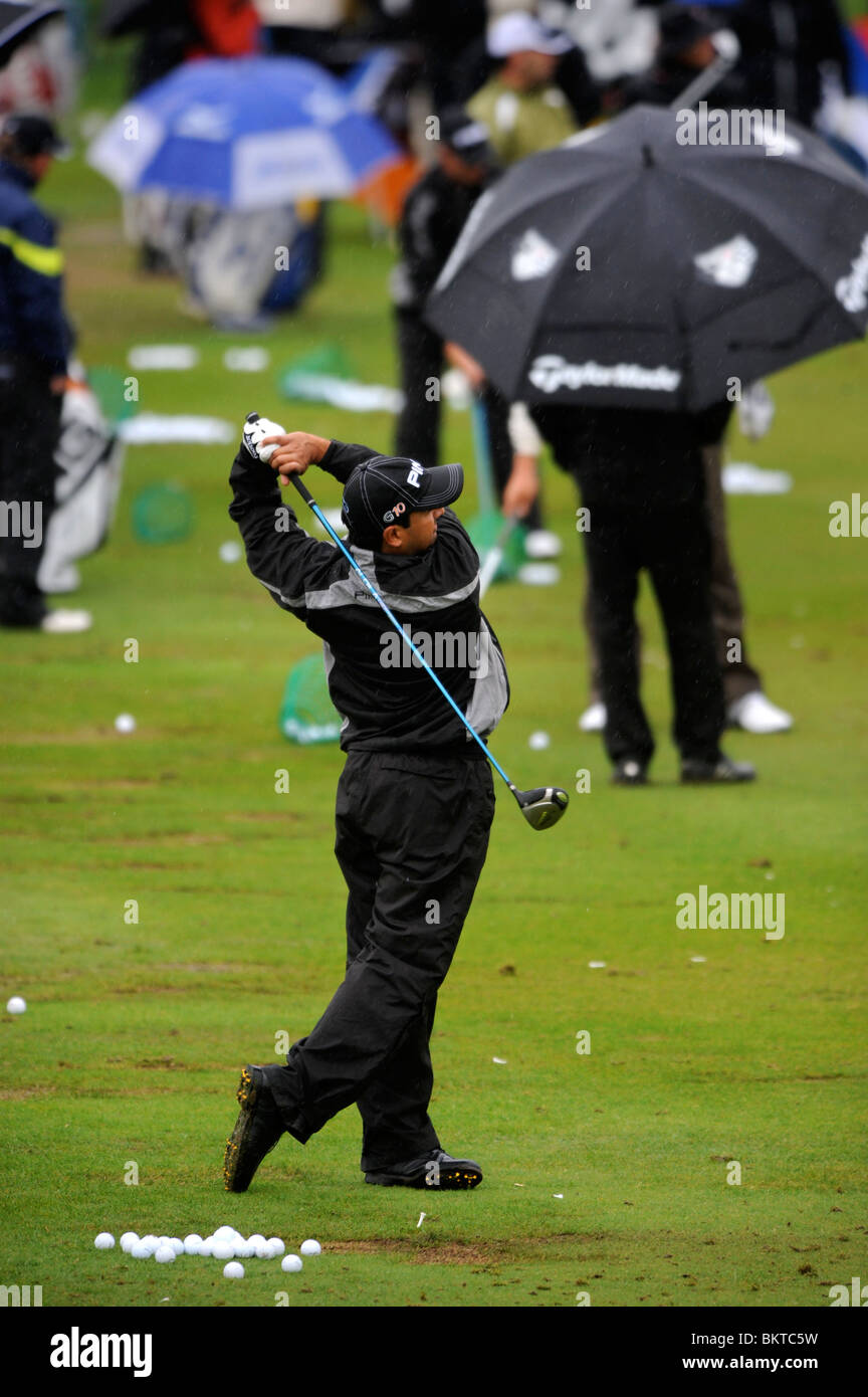 Golfers practise their driving despite the welsh rain at the Celtic Manor Wales Open 2008 - Stock Image