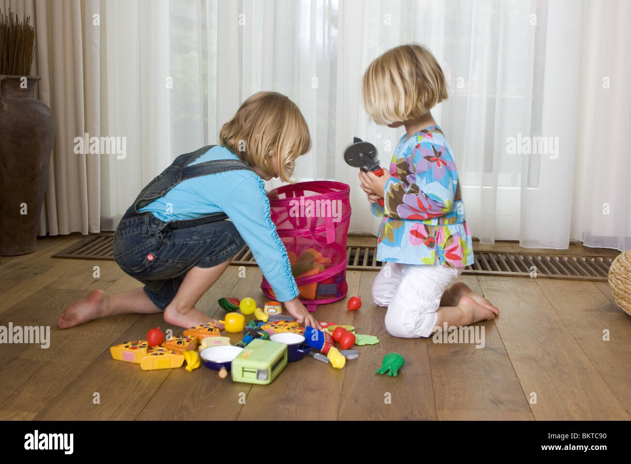 Two Girls Cleaning Up A Room