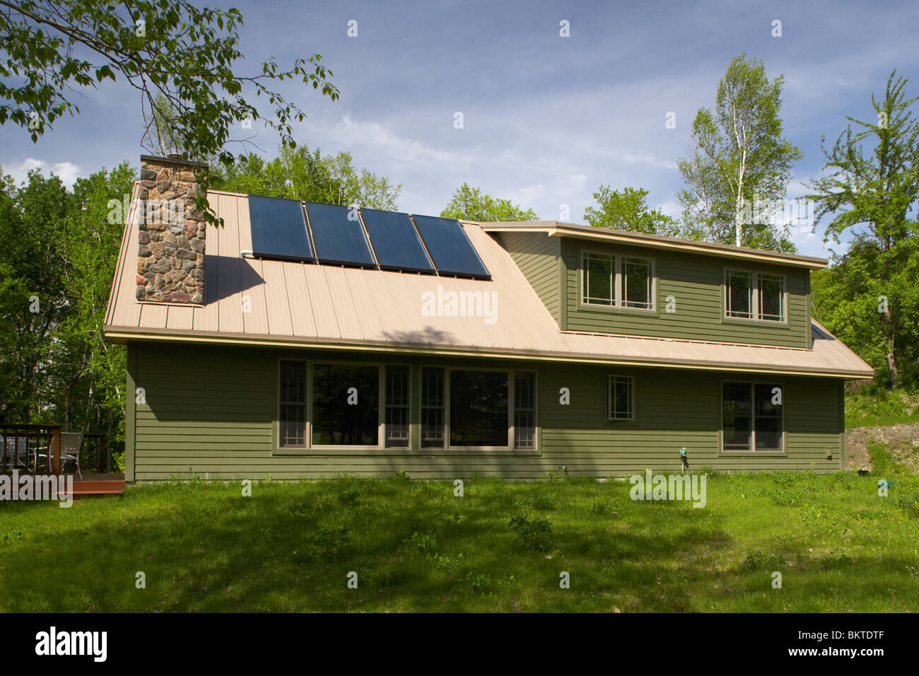 Solar panels on a newly built energy efficient home - Stock Image