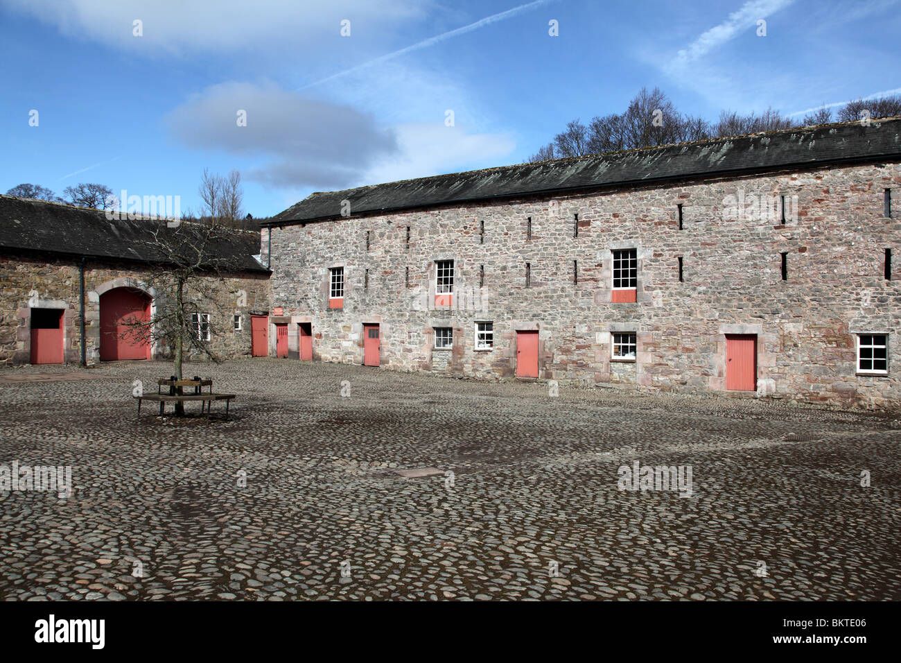 The Great Barn built during the 1500s in the courtyard of Dalemain House, Cumbria, England, UK - Stock Image