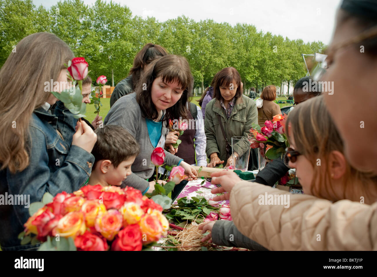 Celebration of World 'Fair Trade' Day, with People Taking Fair Trade Flowers on Lawn of La Villette Park, - Stock Image