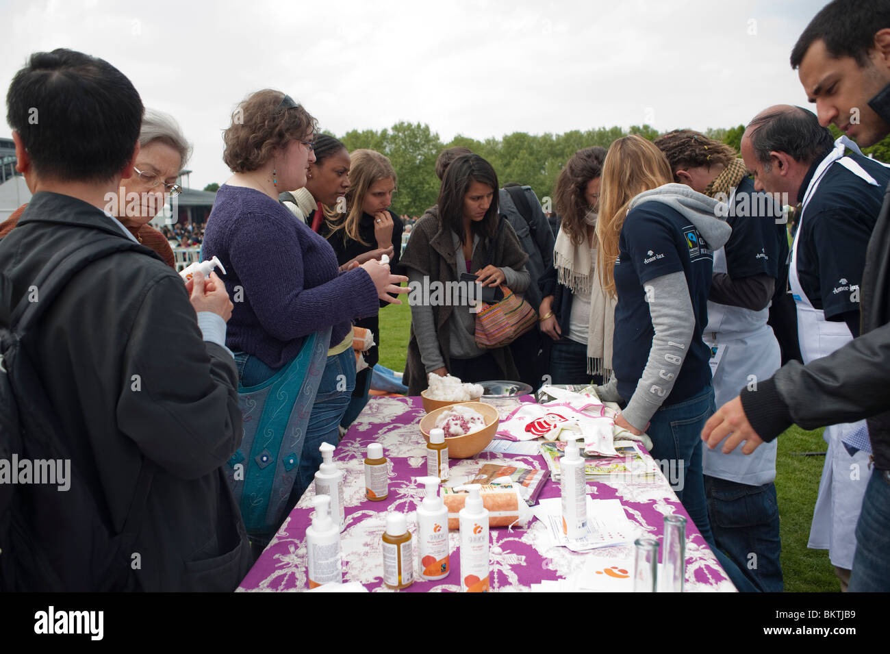 Celebration of World 'Fair Trade' Day, with People with Fair Trade Cotton Samples, on Lawn of La Villette - Stock Image