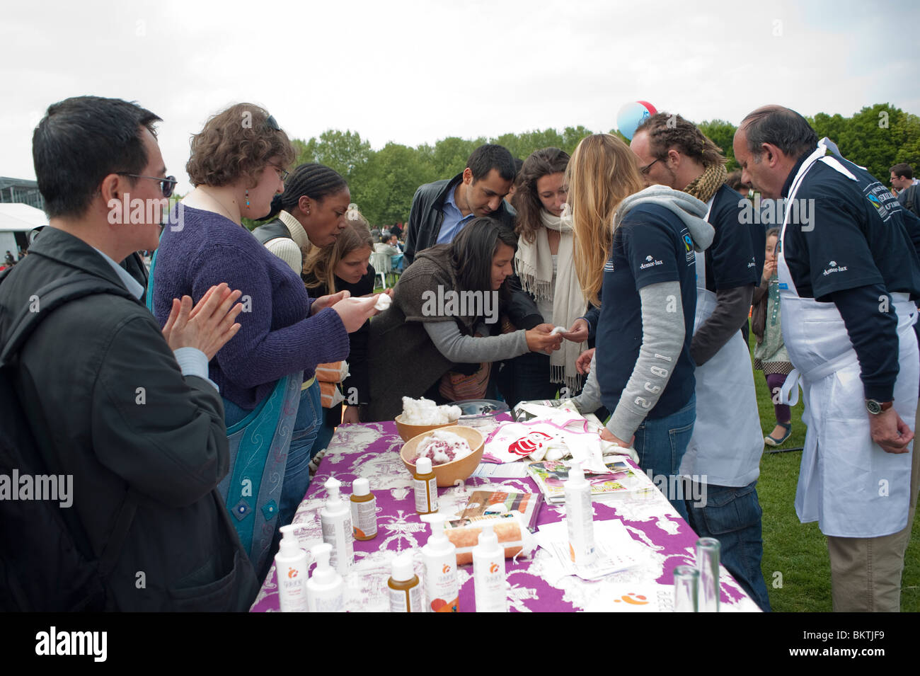 Celebration of World 'Fair Trade' Day, with Women Trying 'Fair Trade', Organic Cosmetics on Lawn - Stock Image