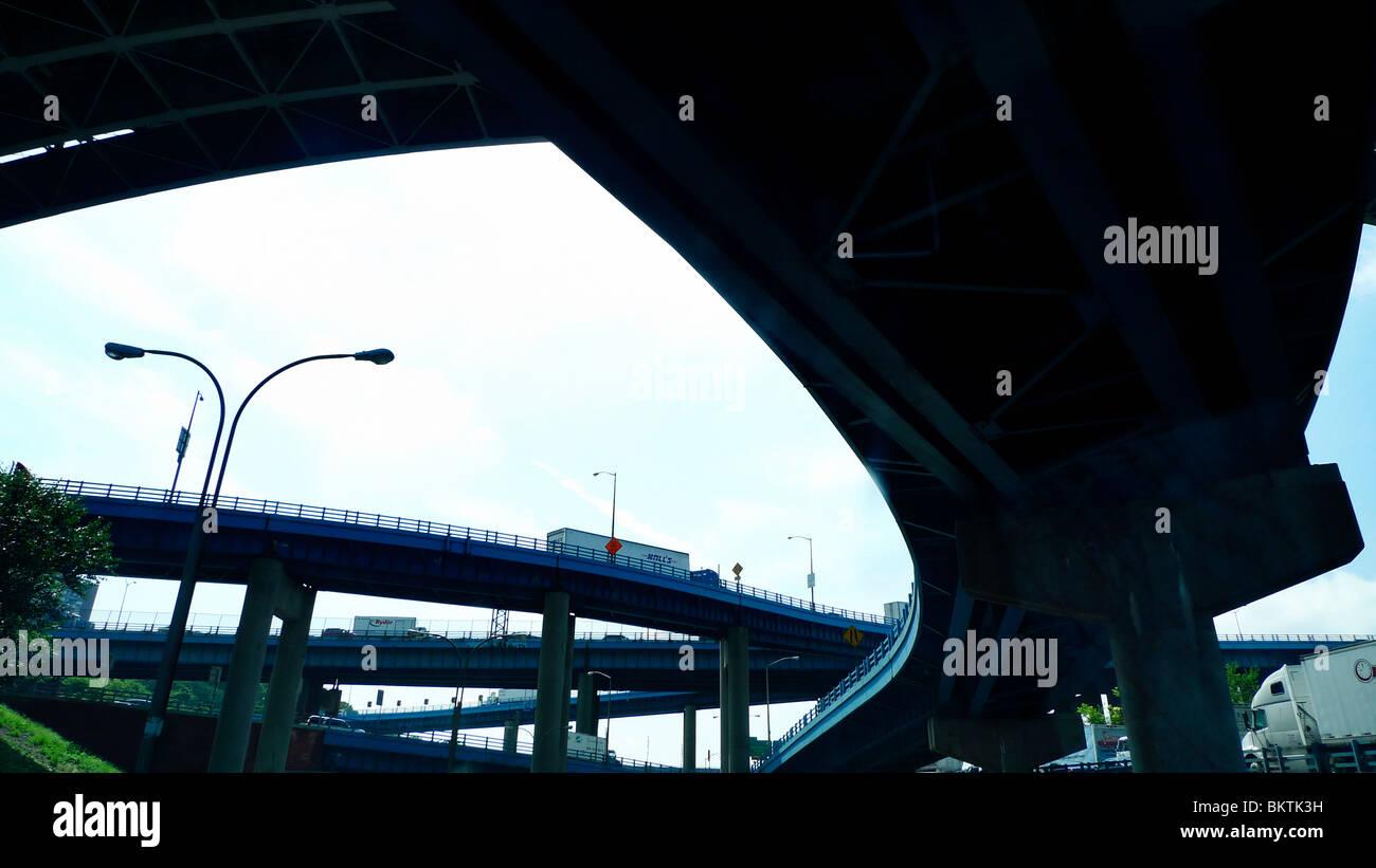 American freeway overpass in busy metropolitan city. - Stock Image