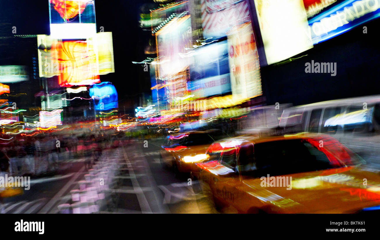 Blurring lights of downtown Times Square, New York City, USA. - Stock Image
