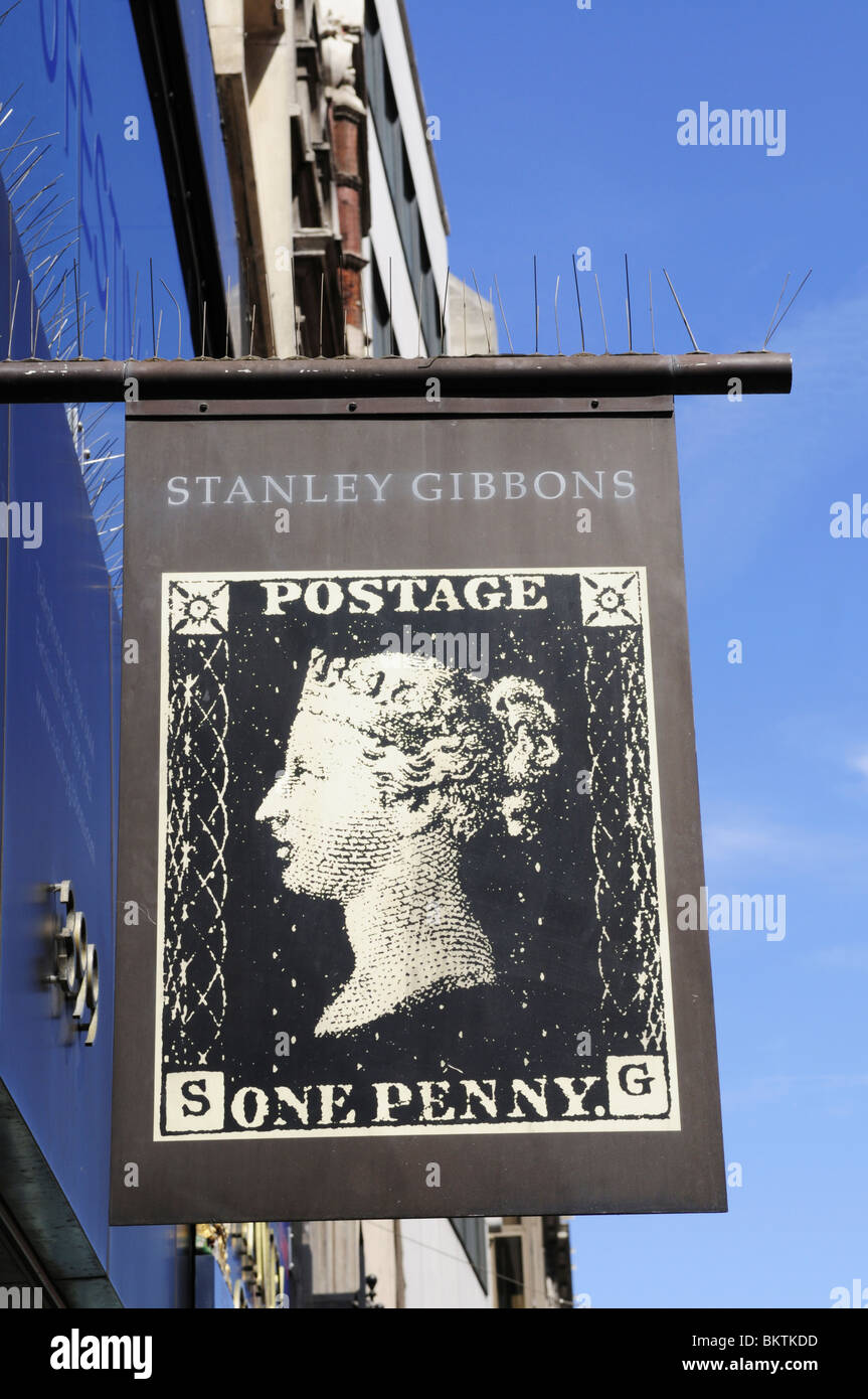 Stanley Gibbons Stamp dealer shop sign, The Strand, London, England, UK - Stock Image
