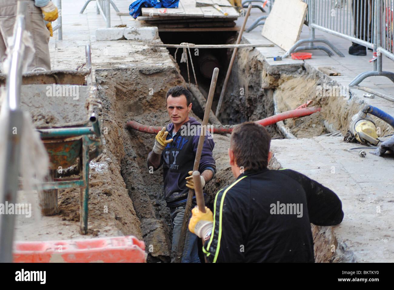 Workmen in Venice, Italy - Stock Image