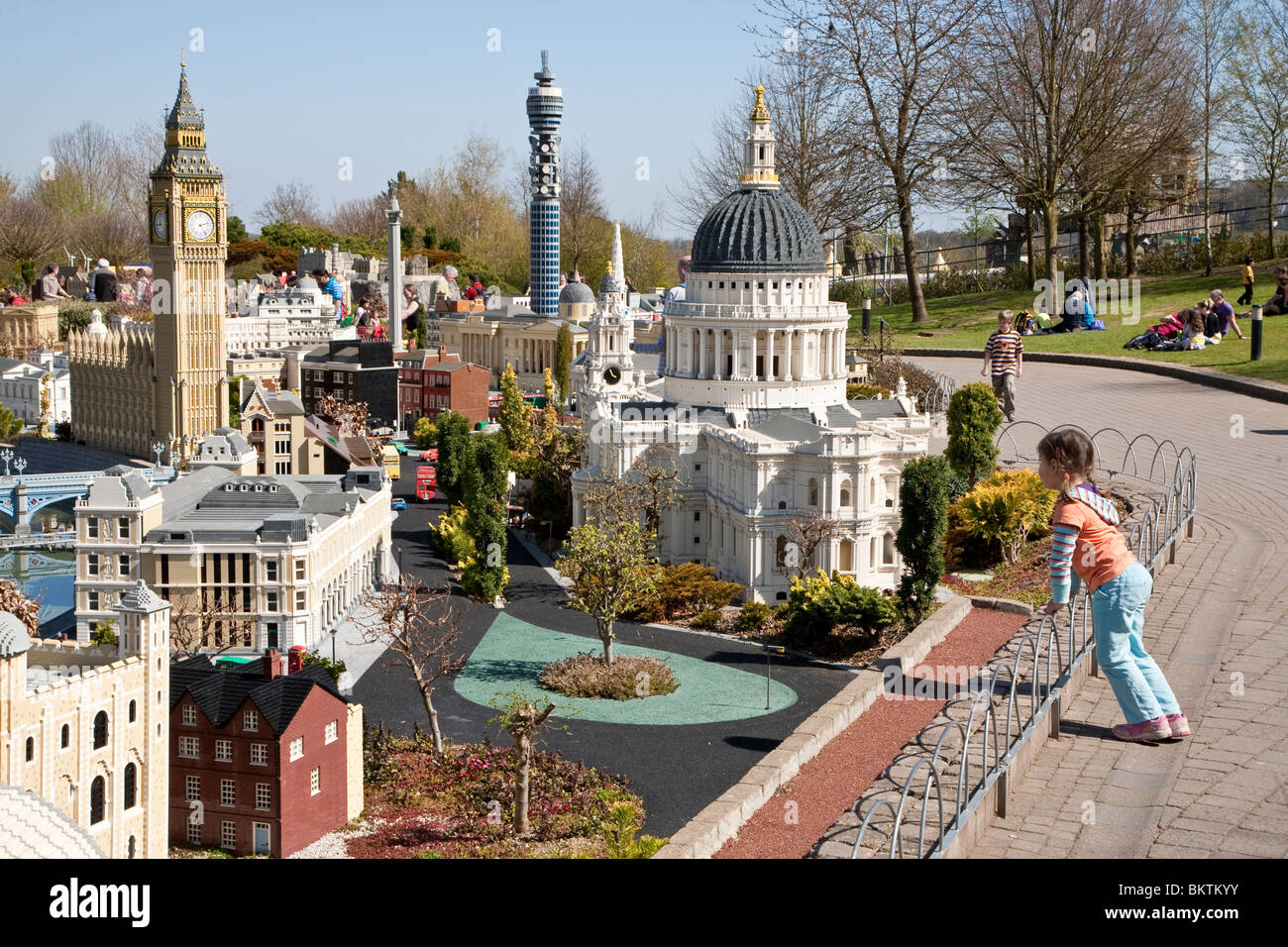 Young girl looking at models of London buildings in Miniland at LEGOLAND Windsor - Stock Image