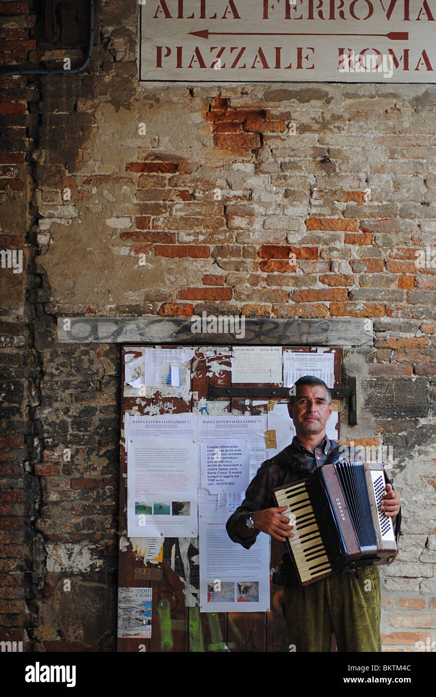 Busker playing an accordion, Venice, Italy - Stock Image