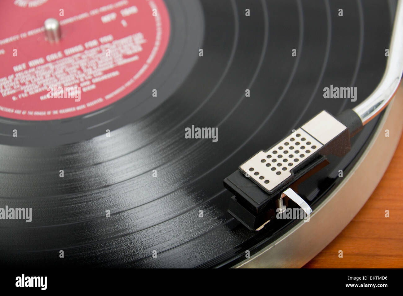 Close-up of vinyl record playing on vintage Garrard turntable - Stock Image