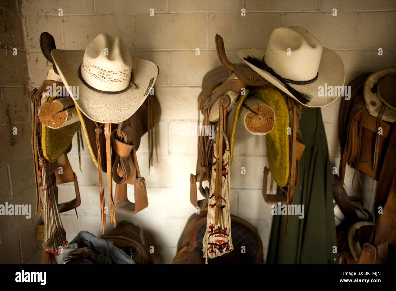 Cowboy hats sit on horse saddles in a stable in Tepotzotlan, Mexico, May 3, 2008. Photo/Chico Sanchez Stock Photo