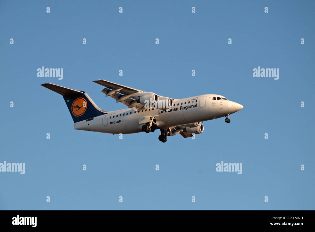A Lufthansa Regional (Lufthansa CityLine) British Aerospace Avro 146-RJ85 landing at London Heathrow, UK.  Aug 2009. - Stock Image