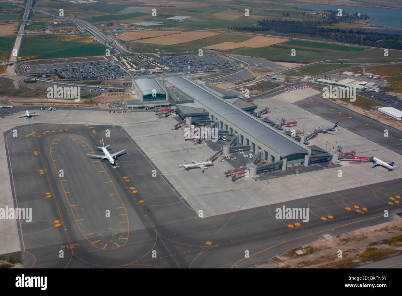 Air transport in the EU. Aerial view of Larnaca Airport, Cyprus, Europe, with the terminal building, apron, taxiways, - Stock Image