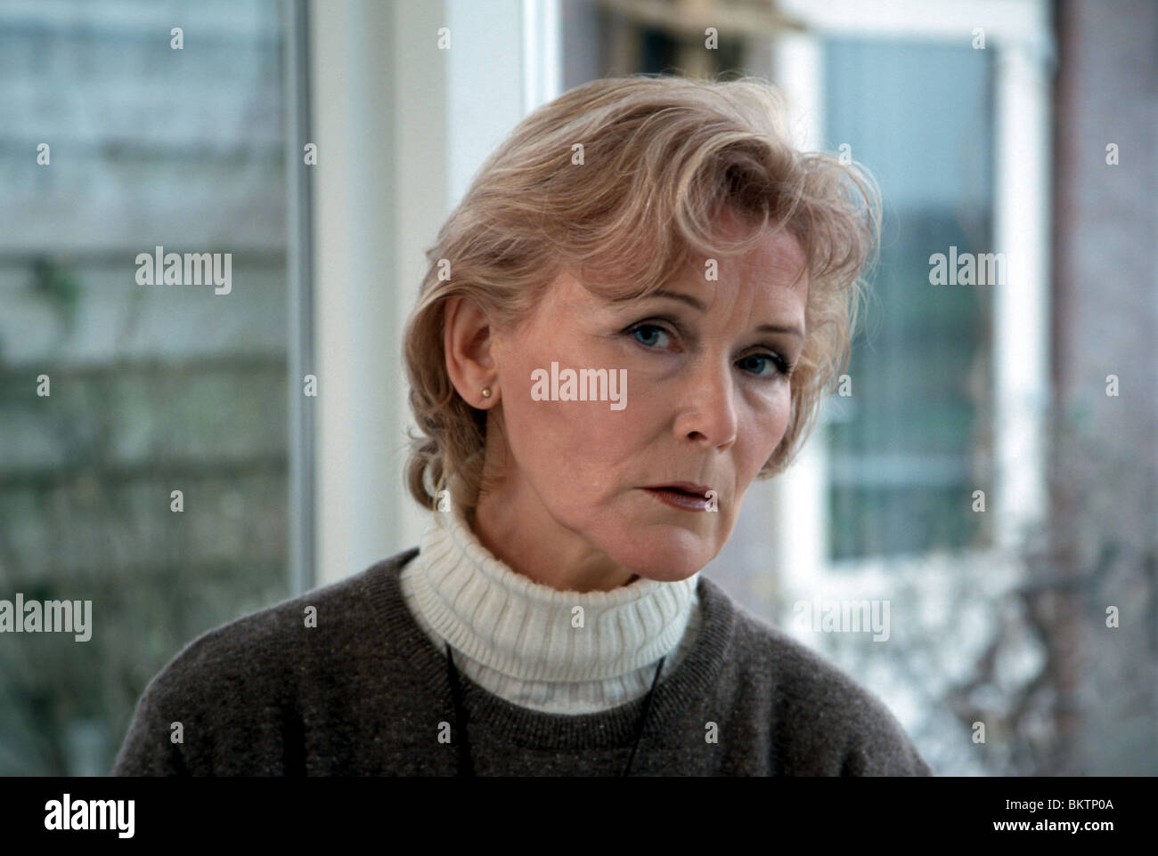 Senior woman thinking - Stock Image