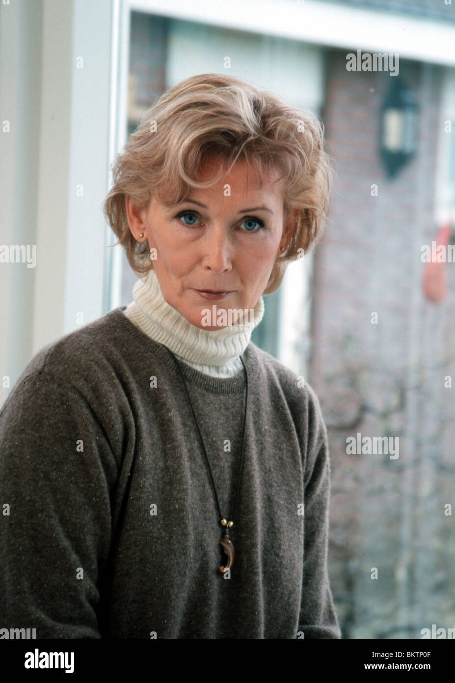 Portraits unhappy woman 50 worried - Stock Image