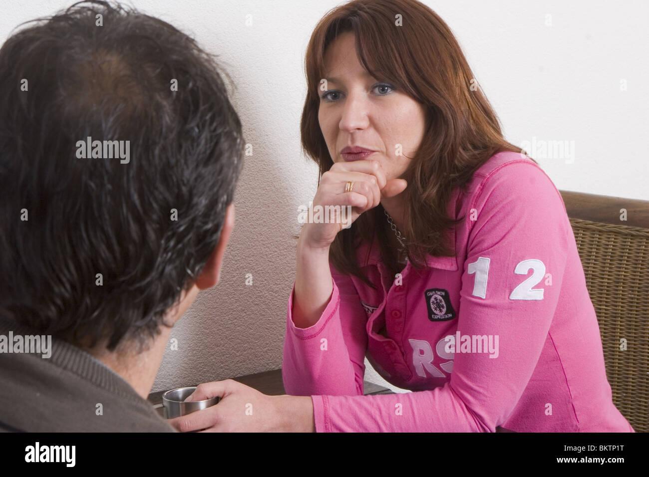 Man woman table talking - Stock Image