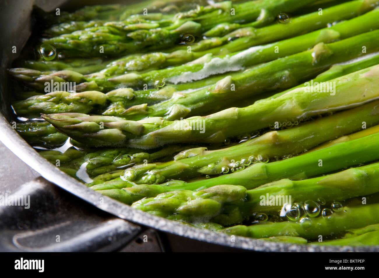 asparagus in pan of boiling water - Stock Image