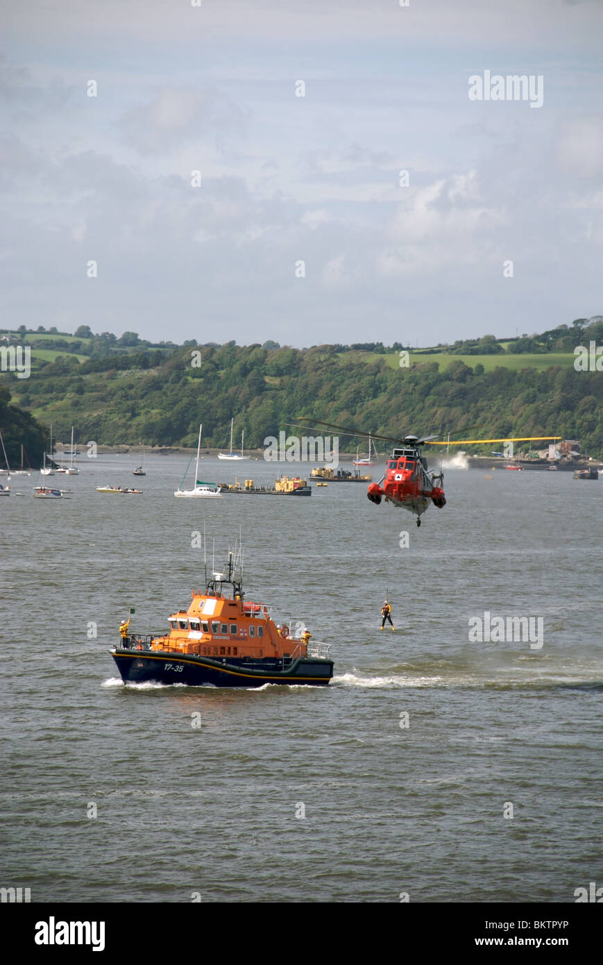 Royal Navy Sea King Rescue helicopter winches RNLI lifeboatmen, Navy Open Days 2009, Devonport, Plymouth, Devon, - Stock Image