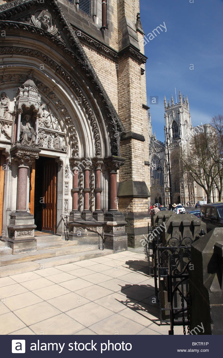 Entrance to St Wilfrid's Catholic Church with York Minster in the background . York North Yorkshire England - Stock Image