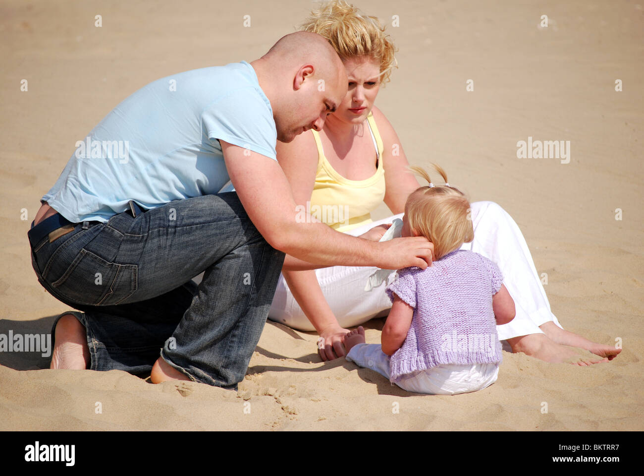 Young family at the beach - Stock Image
