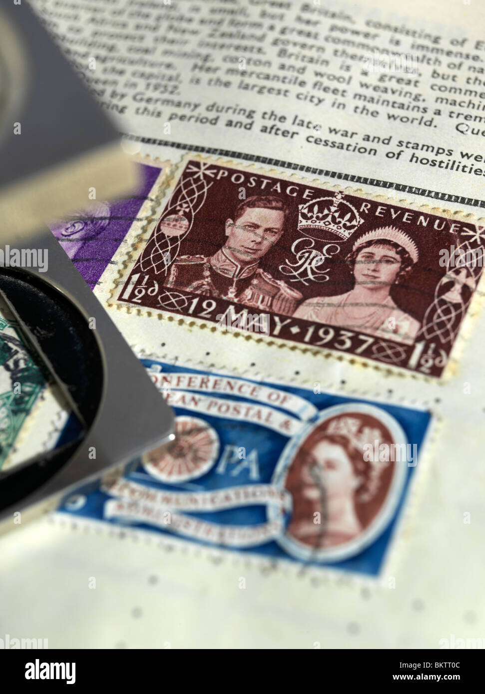Old stamp in album Celebrating the Coronation of King George VI at Westminster Abbey on 12th May, 1937 - Stock Image
