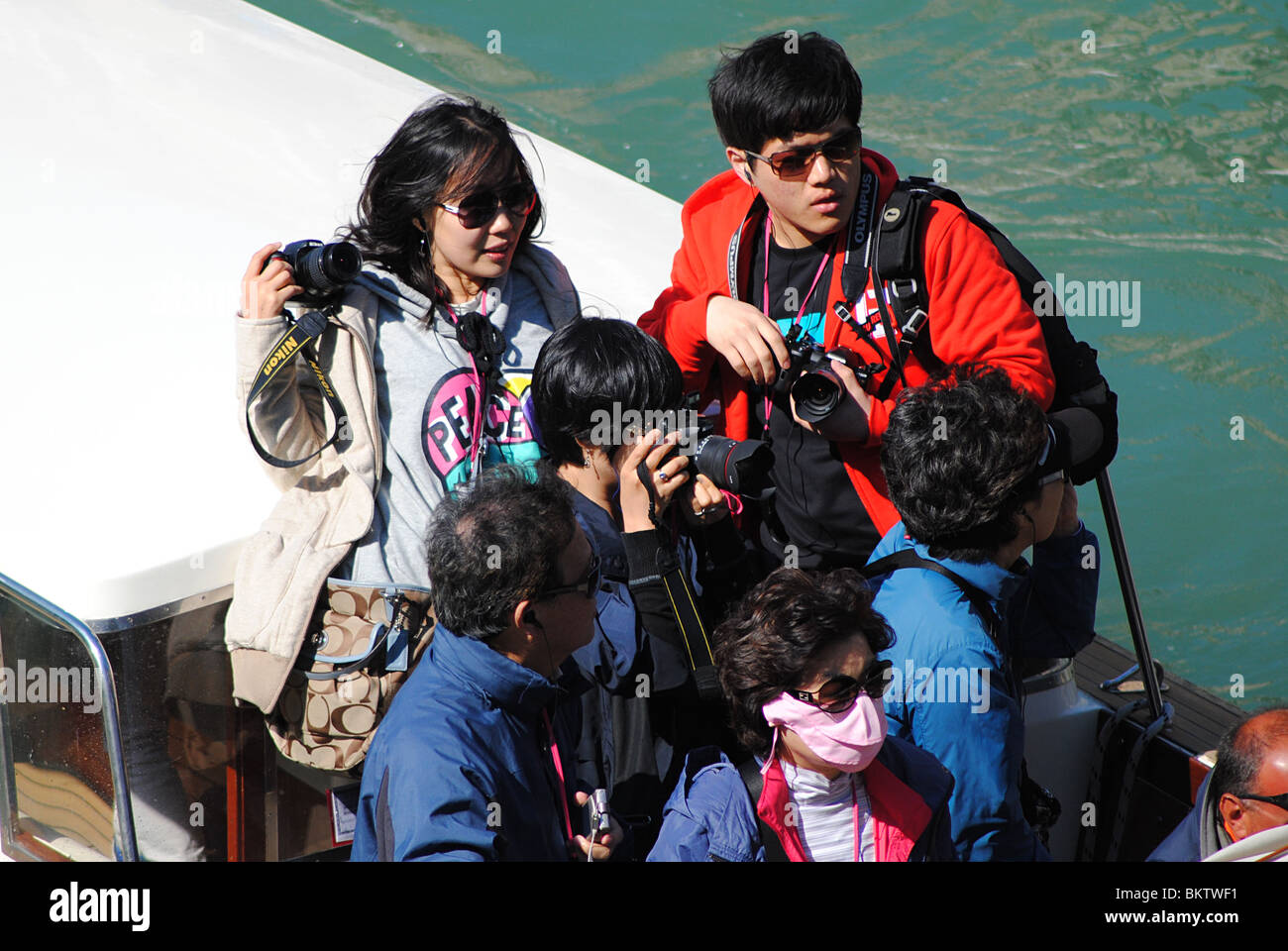 Asian tourists with cameras, Grand Canal, Venice, Italy - Stock Image
