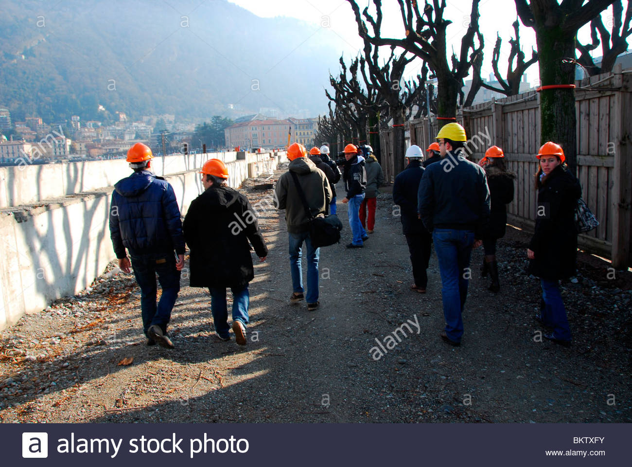 journalists during  the discouragement of the wall on along Como lake,lombardia,italy - Stock Image