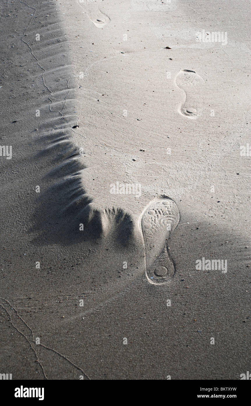 Footprints in sand - Stock Image