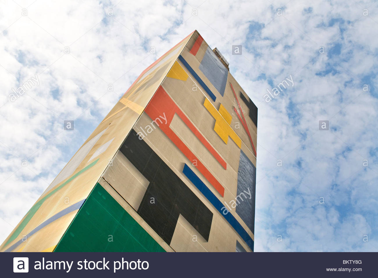 restoration of the Ghirlandina tower,scaffolding covered by a work by Mimmo Paladino,Modena,Emilia Romagna,Italy - Stock Image