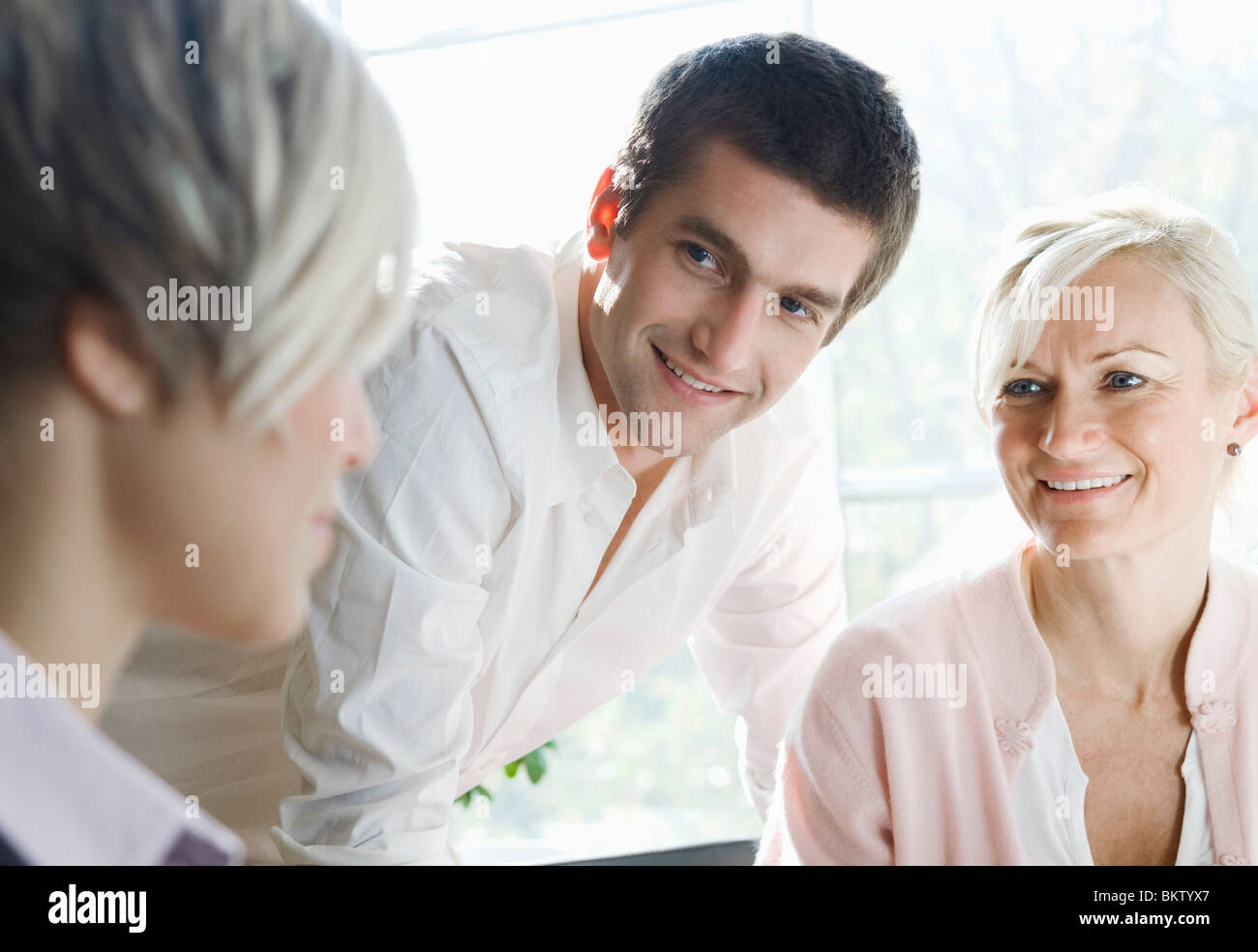 Colleagues at meeting - Stock Image