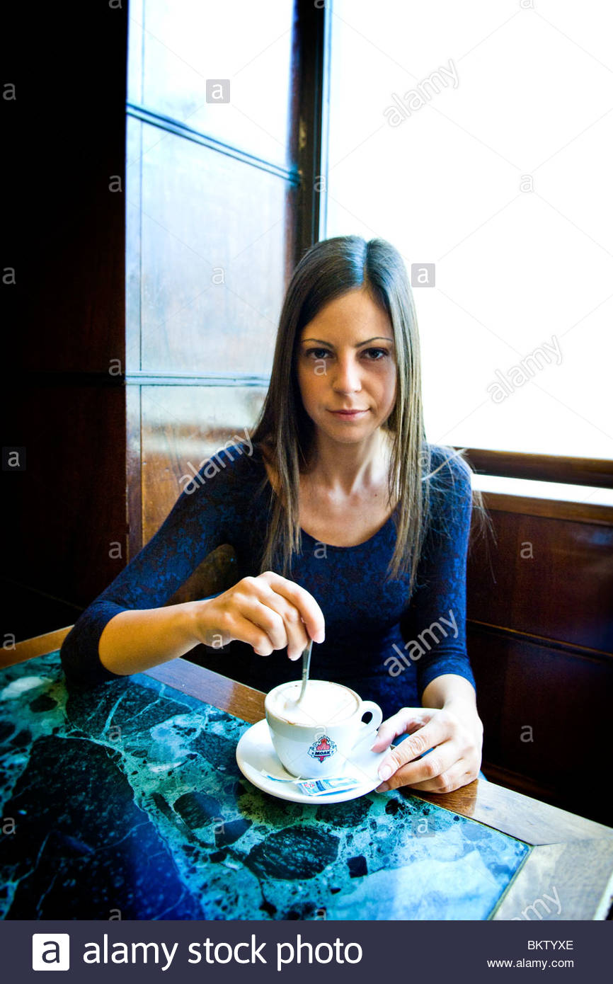 woman drinking cappuccino at the bar - Stock Image