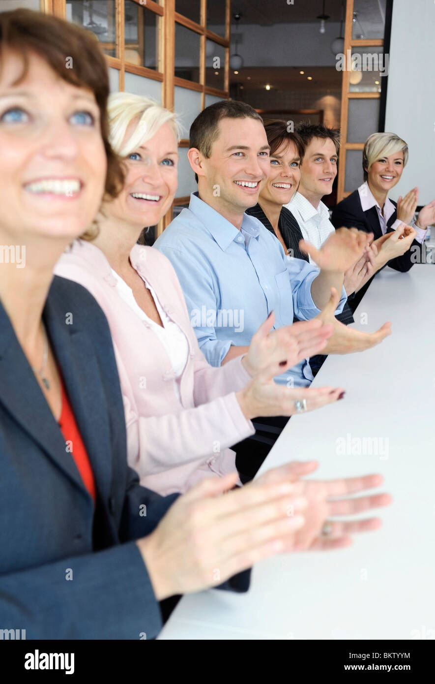 Colleagues clapping one's hands - Stock Image