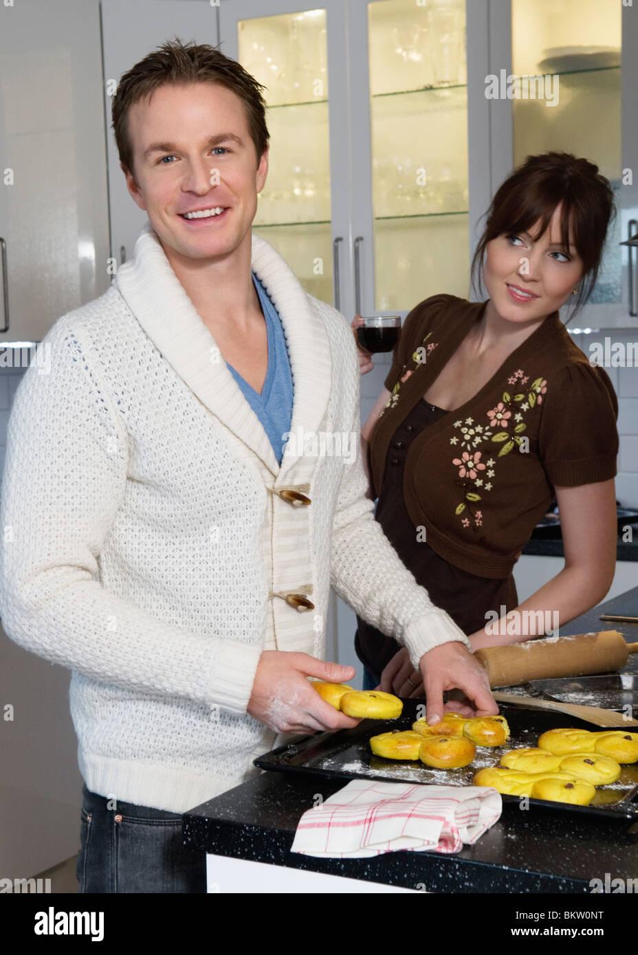 Man and woman baking lucia bun Stock Photo