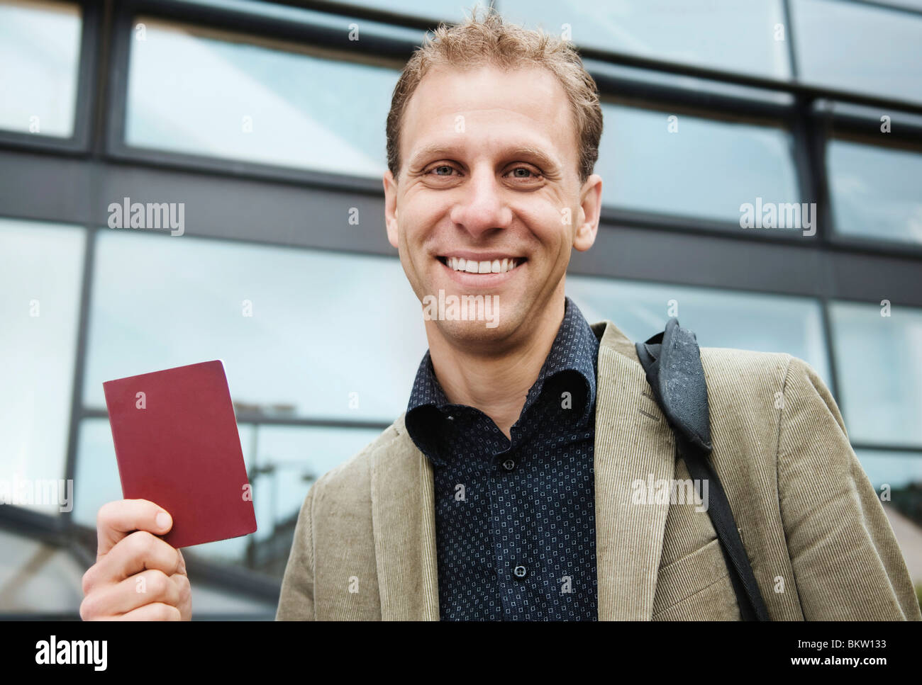 Man holding passport - Stock Image