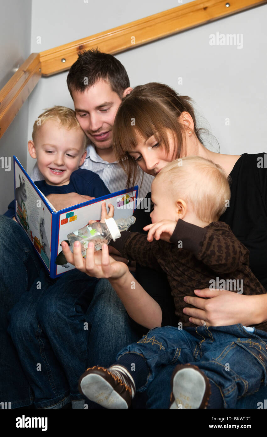 Family reading a story - Stock Image
