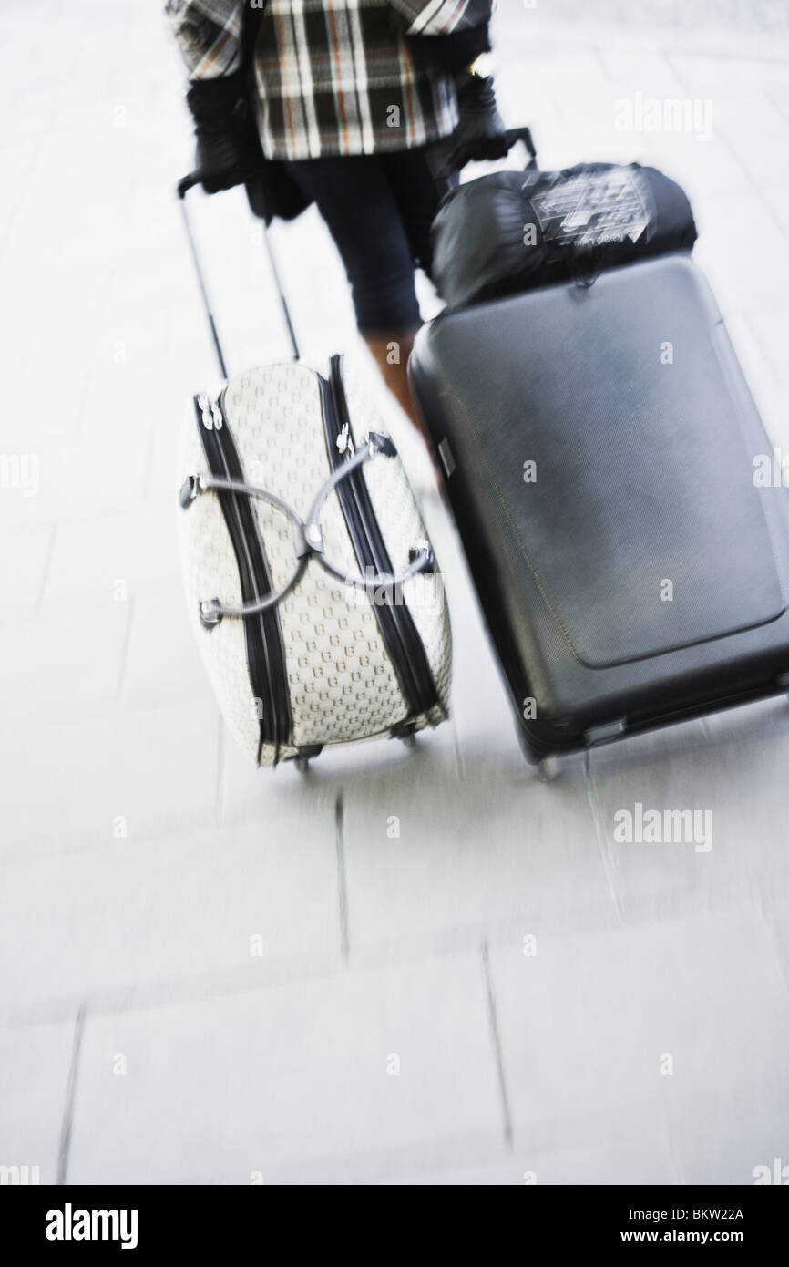 Woman with suit cases Stock Photo