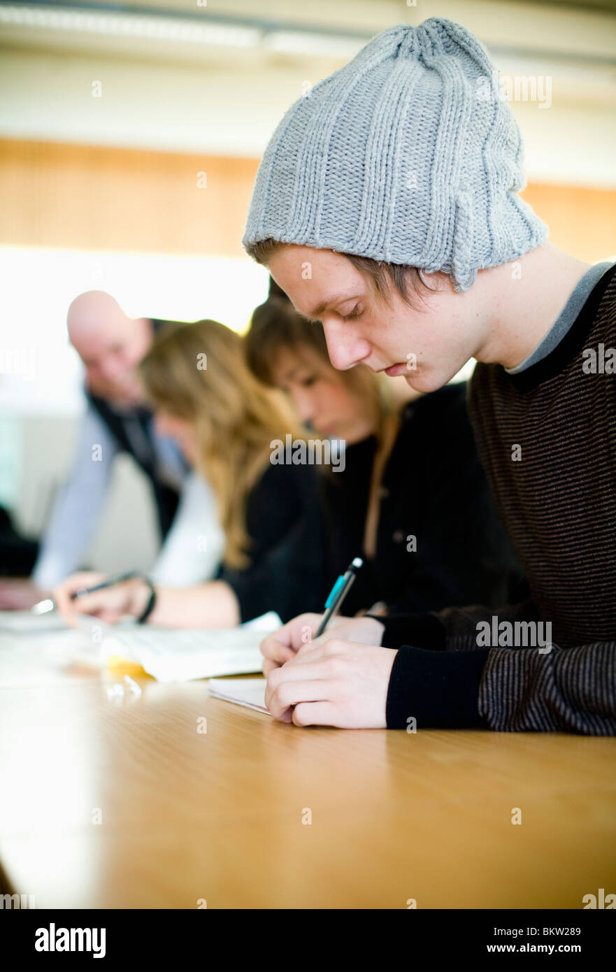 Student with hat indoors - Stock Image