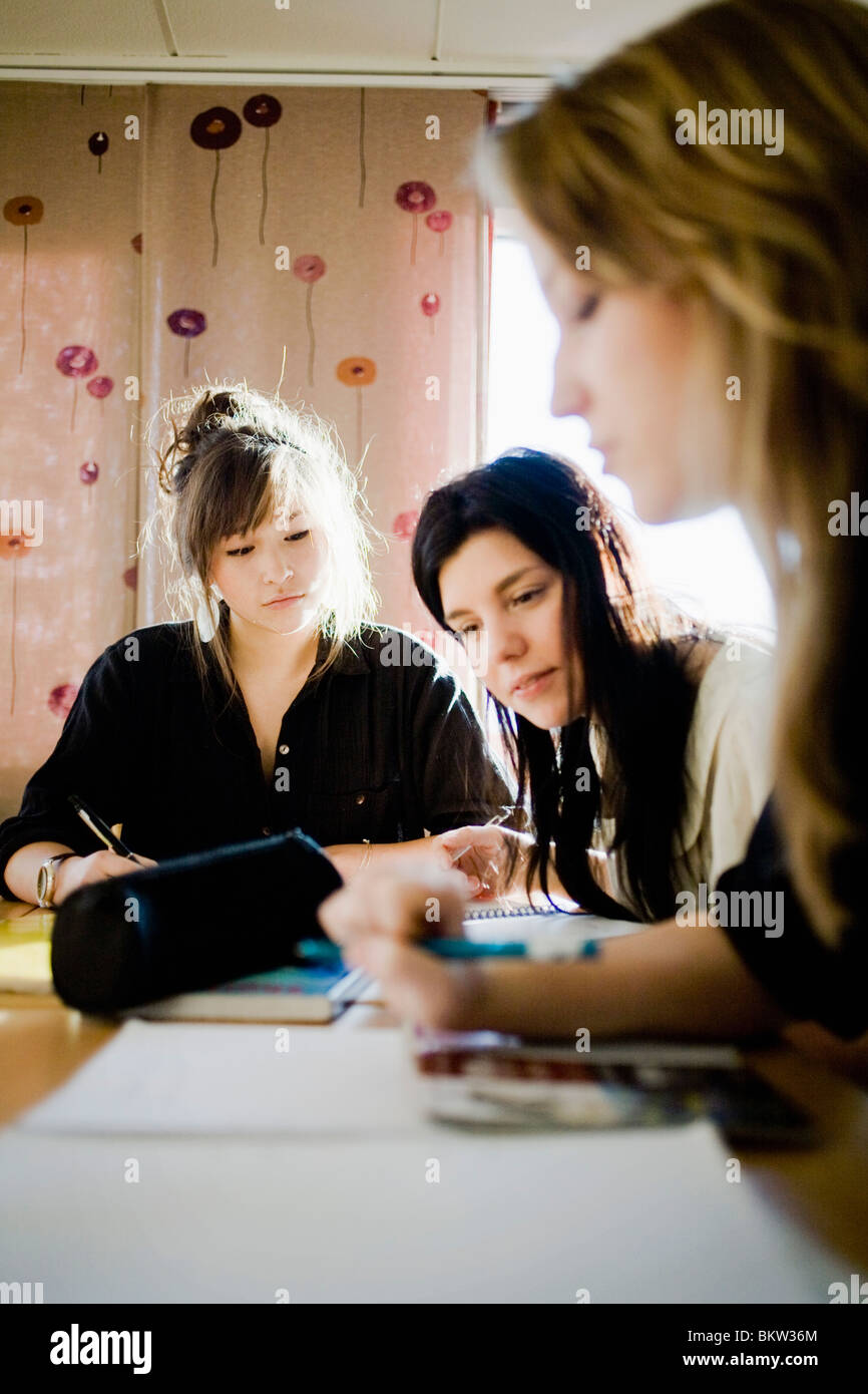 Three pupils working together Stock Photo