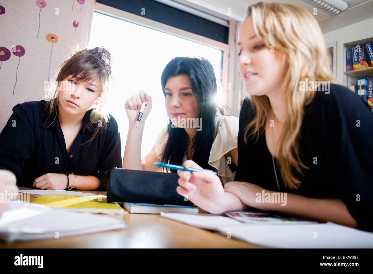 Three concentrated girls Stock Photo