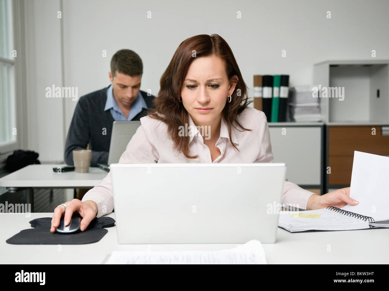 Concentrated coworker at office - Stock Image