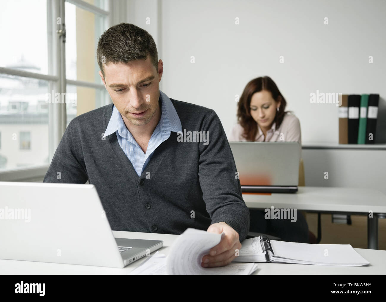 Two coworkers at office - Stock Image