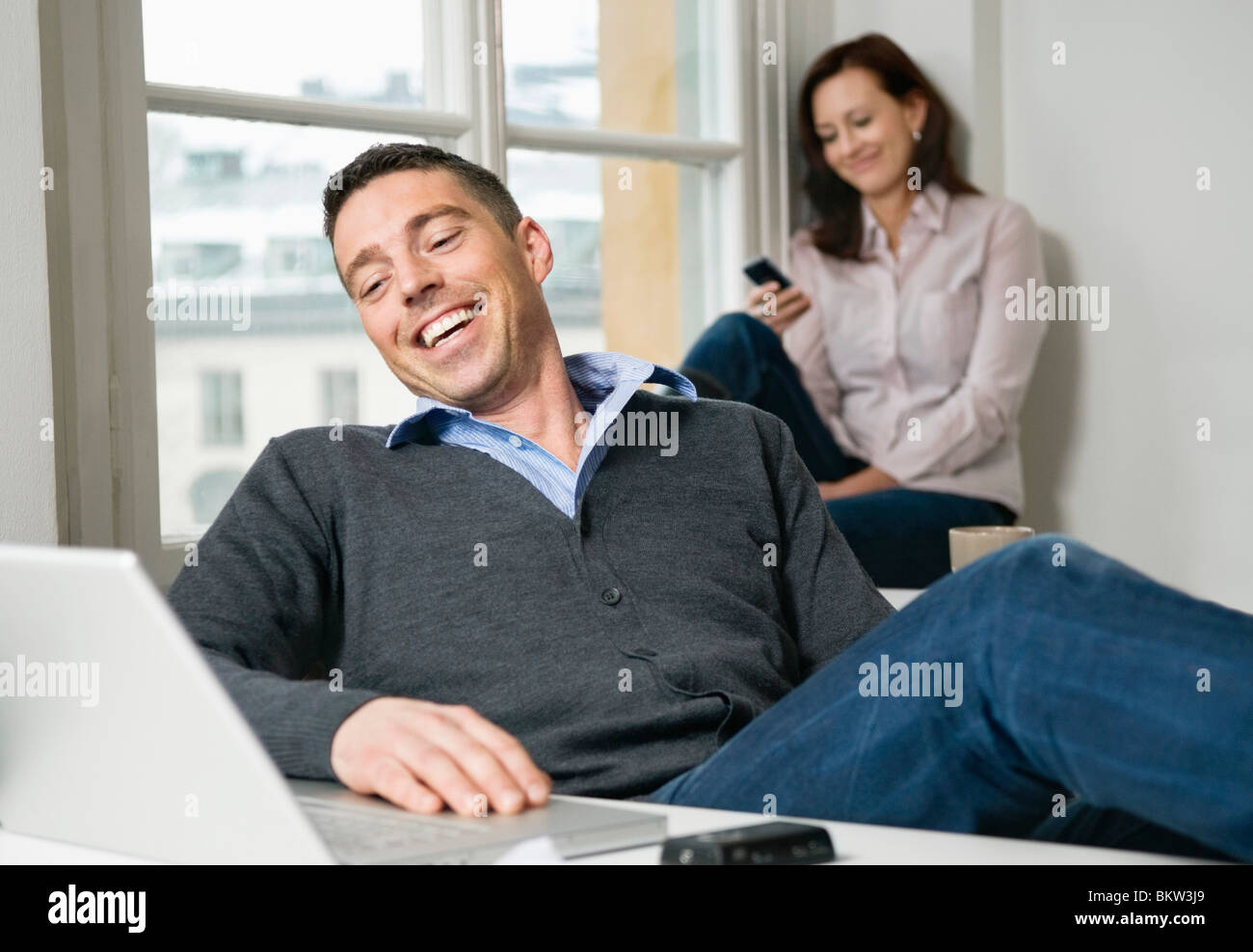 Laidback coworkers at office - Stock Image