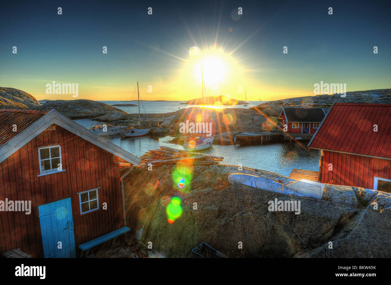 Sunset over fishing village - Stock Image