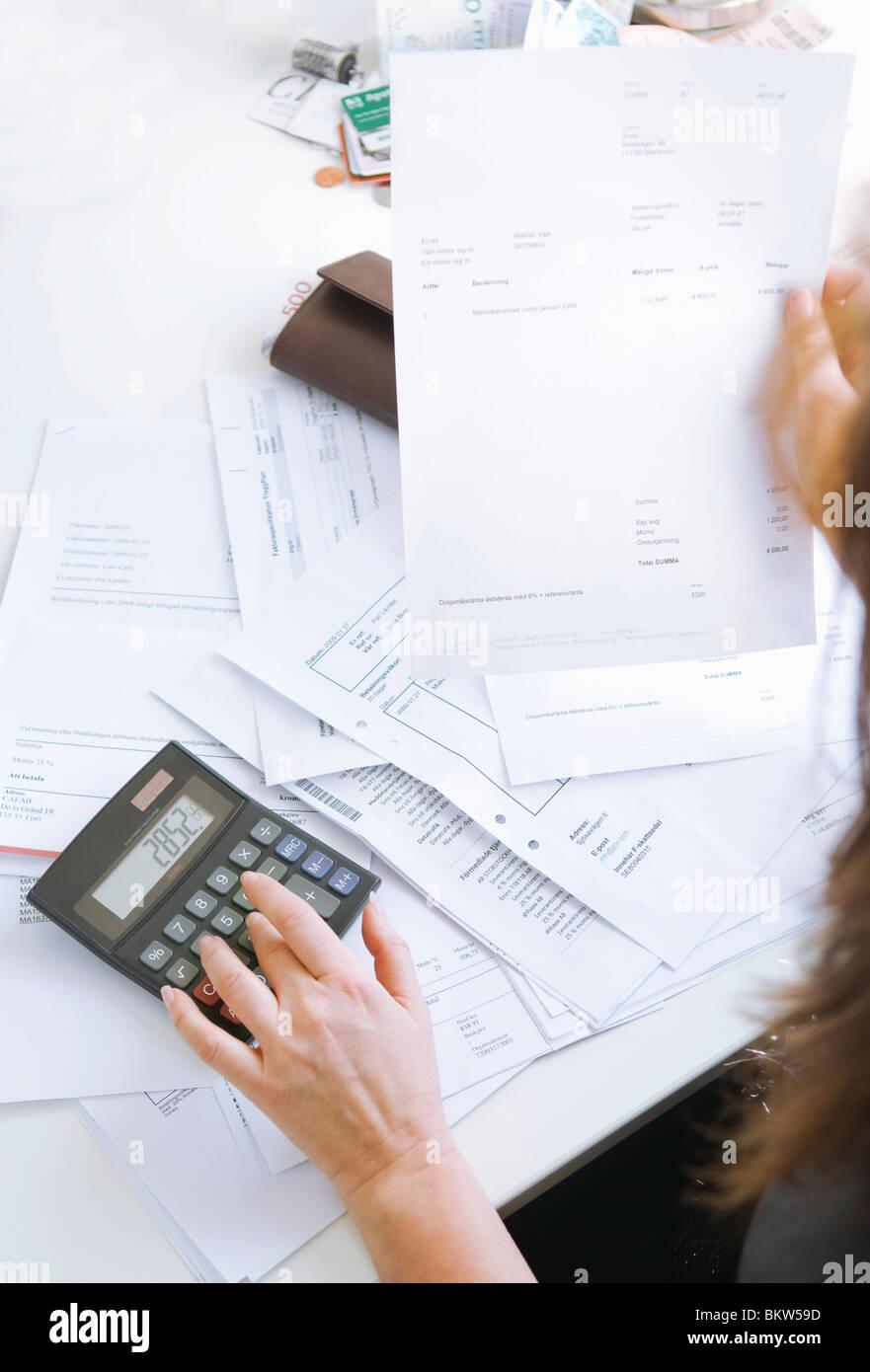 Woman paying bills - Stock Image