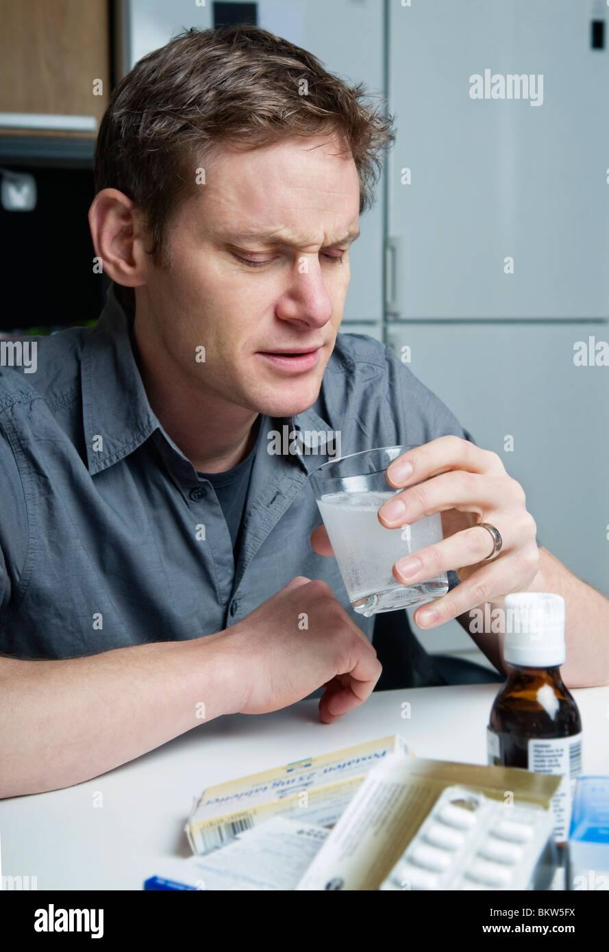 Man with medicine - Stock Image