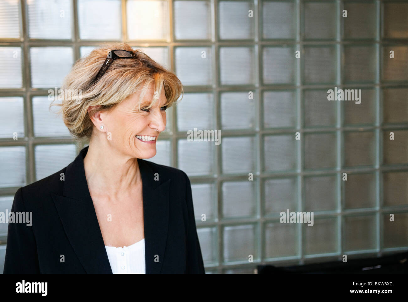 A happy businesswoman - Stock Image